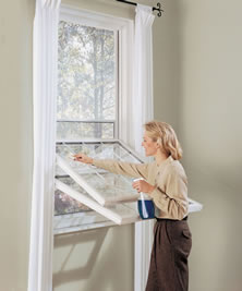 Energy efficient replacement double hung windows easily maintained.